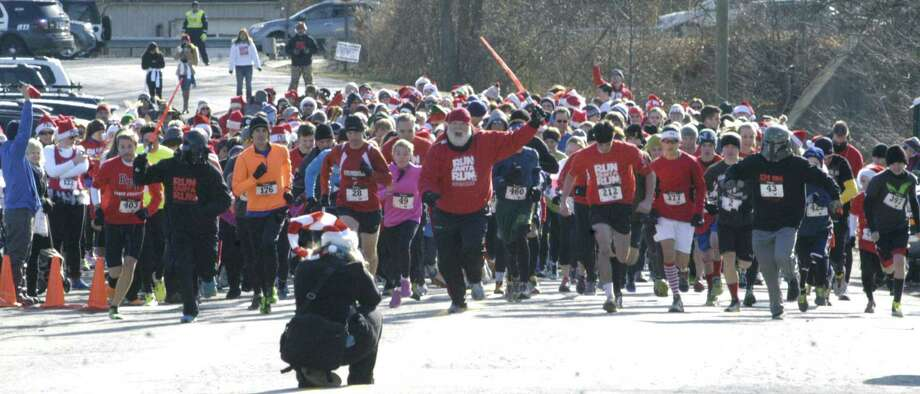 Race director Bil Buckbee raises his light saber to signal the start of ìRun, Santa, Runî 5K Run/Walk, an event started and finished Nov. 30, 2013 at Youngís Field in New Milford. Proceeds from the event, hosted by St. Peterís Lodge No. 21 Ancient Free and Accepted Masons of New Milford, will benefit the American Diabetes Association and Masonicare. Photo: Norm Cummings / The News-Times