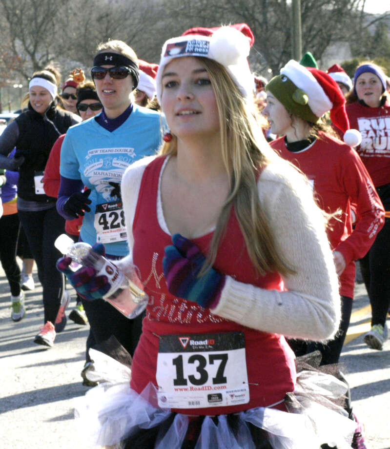 Enthusiastic runners kick into high gear at the start of ìRun, Santa, Runî 5K Run/Walk, an event started and finished Nov. 30, 2013 at Youngís Field in New Milford. Proceeds from the event, hosted by St. Peterís Lodge No. 21 Ancient Free and Accepted Masons of New Milford, will benefit the American Diabetes Association and Masonicare. Photo: Norm Cummings / The News-Times