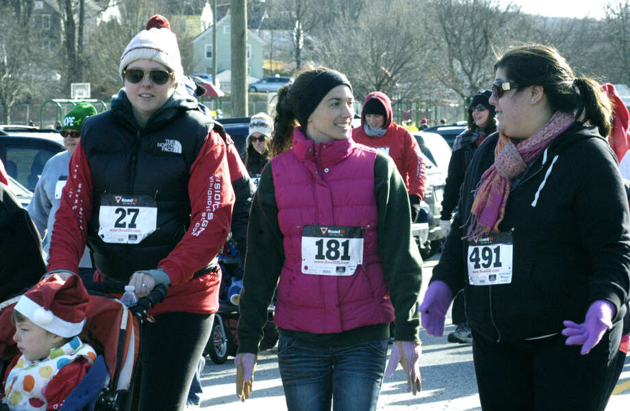 Enthusiastic walkers kick into high gear at the start of ìRun, Santa, Runî 5K Run/Walk, an event started and finished Nov. 30, 2013 at Youngís Field in New Milford. Proceeds from the event, hosted by St. Peterís Lodge No. 21 Ancient Free and Accepted Masons of New Milford, will benefit the American Diabetes Association and Masonicare. Photo: Norm Cummings / The News-Times