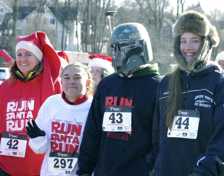 Darth Vader and several of his congenial storm troopers take a break from their empire building exploits to join in at the start of ìRun, Santa, Runî 5K Run/Walk, an event started and finished Nov. 30, 2013 at Youngís Field in New Milford. Proceeds from the event, hosted by St. Peterís Lodge No. 21 Ancient Free and Accepted Masons of New Milford, will benefit the American Diabetes Association and Masonicare. Photo: Norm Cummings / The News-Times