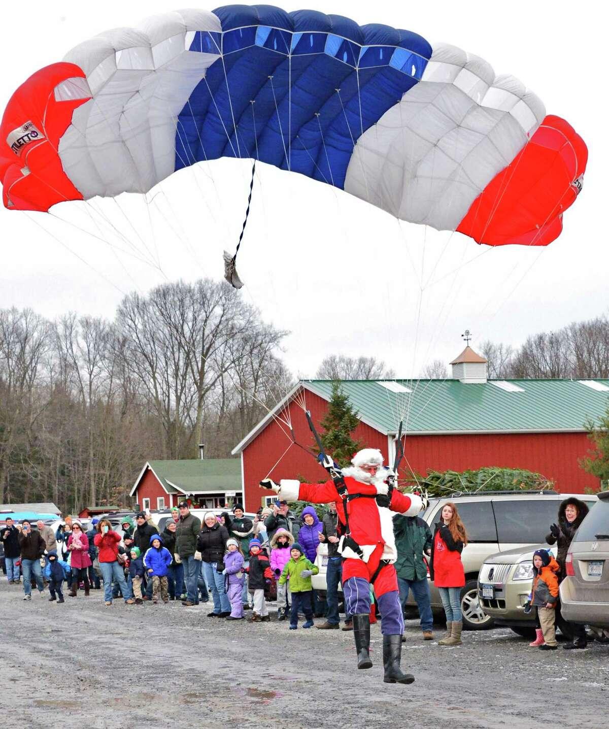 Santa parachutes in to the Ellms Christmas Tree Farm Saturday Nov. 30, 2013, in Ballston Spa, NY. (John Carl D'Annibale / Times Union)