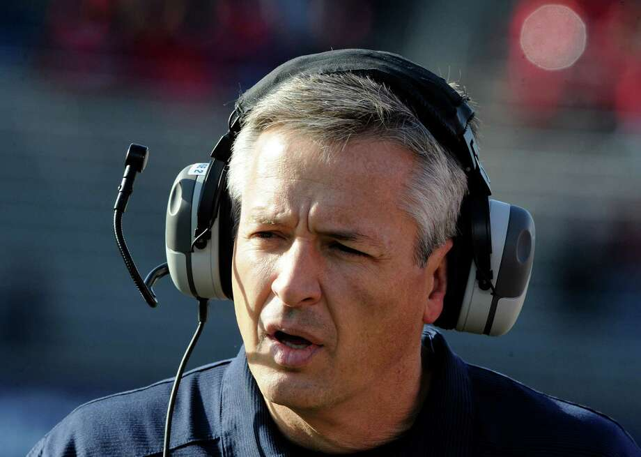 Connecticut head coach T.J. Weist reacts during the first half an NCAA college football game against Rutgers in East Hartford, Conn., on Saturday, Nov. 30, 2013. Photo: Fred Beckham, AP / Associated Press