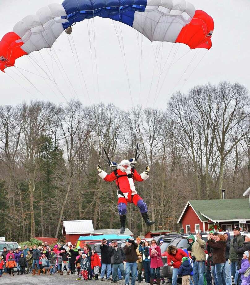 Santa parachutes in to the Ellms  Christmas Tree Farm Saturday Nov. 30, 2013, in Ballston Spa, NY.  (John Carl D'Annibale / Times Union) Photo: John Carl D'Annibale / 00024698A