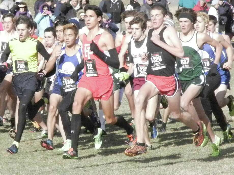 Fairfield Prep senior Christian Alvardo (22) just after the start of the Foot Locker Northeast Regional cross country championship meet on Saturday, Nov. 30 at Van Cortlandt Park in the Bronx, N.Y. Alvardo was second and qualified for the nationals on Dec. 14 in San Diego, Calif. Photo: Reid L. Walmark / Fairfield Citizen