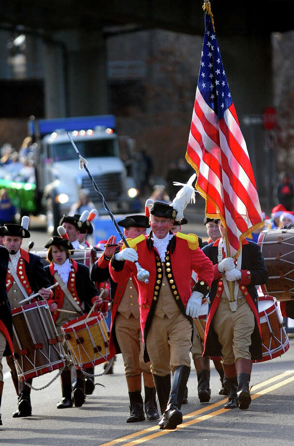 The Mattatuck Drum Band, from Waterbury, makes its way up Route 67 during the 42nd Annual Seymour Merchants Christmas Parade in downtown Seymour, Conn. on Saturday November 30, 2013. Photo: Christian Abraham / Connecticut Post