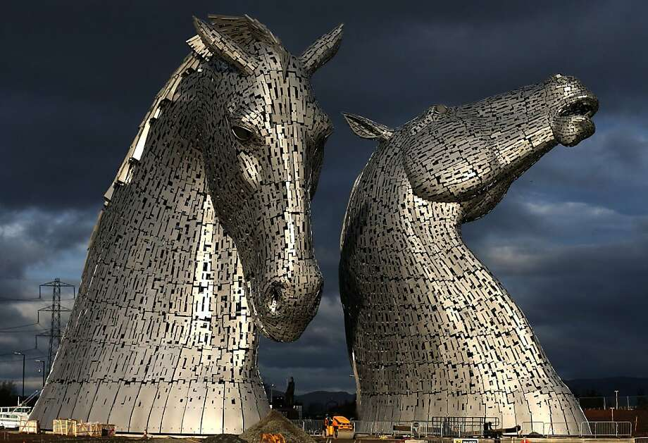 The Kelpies, a public art and visitor attraction created by artist Andy Scott, stands on its completion as a gateway to the Forth and Clyde canal at the Helix, Falkirk, Scotland, Wednesday Nov. 27, 2013. The dramatic horse heads are made of 600 tonnes of steel and were inspired by the tradition of working horses in Scotland that pulled barges along canals and worked in the fields where The Kelpies now stand. Photo: Andrew Milligan, Associated Press