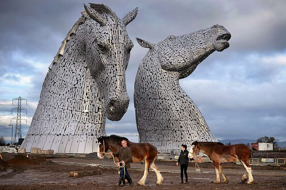 Andy Scott stands with Clydesdale Horses Duke and Baron and Donna Auchinvole during a topping out ceremony at The Kelpies on November 27, 2013 in Falkirk, Scotland. Construction work has been completed on Andy Scott's Kelpies, the world's largest pair of equine sculptures and one of the UK's tallest pieces of public art.  Photo: Jeff J Mitchell, Getty Images