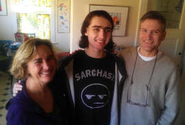 Sasha Fleischman with parents Debbie Crandall and Karl Fleischman, who opposed trying Sasha's attacker as an adult.