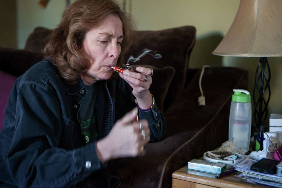 11/26/13 2:30:30 PM -- Albuquerque NM -- Yvette McClelland smokes prescription medical cannabis at her home in Albuquerque NM. -- Photo by Steven St John