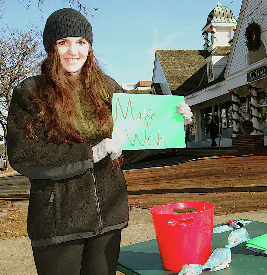 "Lauren Onofrio, 17, a senior at Fairfield Ludlowe High School, sells ""reindeer food"" to raise funds for Make A Wish Foundation on Saturday at Sherman Green. Photo: Mike Lauterborn / Fairfield Citizen contributed"