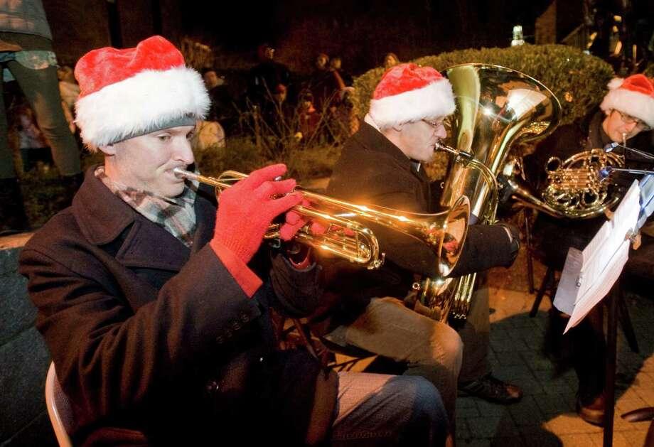 Regal Brass members Kevin Murphy, Tom Lemak and Tim Takagi provide Christmas music at the Danbury Library Plaza Light the Lights program. Saturday, Nov. 30, 2013 Photo: Scott Mullin / The News-Times Freelance