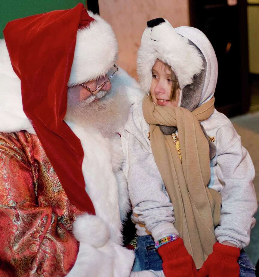 Santa Claus chats with eight year old Merissa Parker at the Danbury Library Plaza Light the Lights program. Saturday, Nov. 30, 2013 Photo: Scott Mullin / The News-Times Freelance