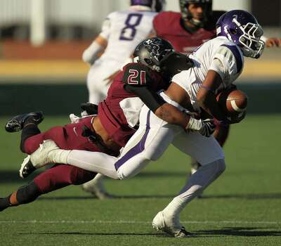 George Ranch's Reggie Solomon, left, tackles Elgin's Anthony Nash during the second half of a high school football playoff game, Saturday, November 30, 2013, at the Berry Center in Cypress. Photo: Eric Christian Smith, For The Chronicle