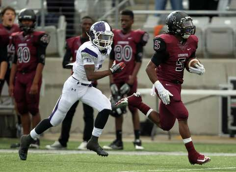 George Ranch's Xavian Marks, right,  runs past Elgin's Devante Garner for a touchdown during the first half of a high school football playoff game, Saturday, November 30, 2013, at the Berry Center in Cypress. Photo: Eric Christian Smith, For The Chronicle