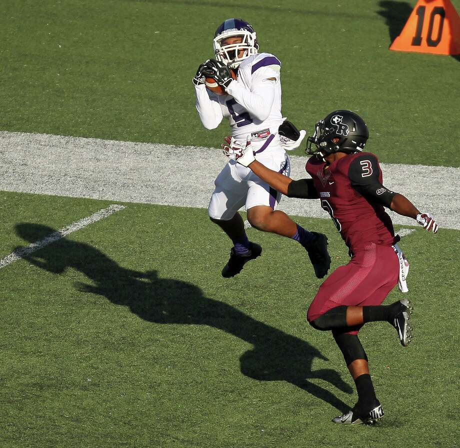 Elgin's Da'Trean Simmons, left, hauls in a 56-yard touchdown reception over George Ranch's Roy Washington during the second half of a high school football playoff game, Saturday, November 30, 2013, at the Berry Center in Cypress. Photo: Eric Christian Smith, For The Chronicle