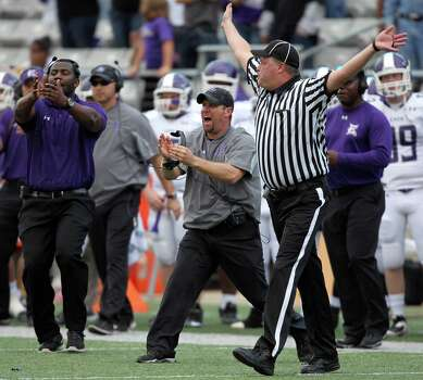 Elgin head coach Wade Griffin, center, calls a timeout in the final minutes of a high school football playoff game against George Ranch, Saturday, November 30, 2013, at the Berry Center in Cypress. Photo: Eric Christian Smith, For The Chronicle
