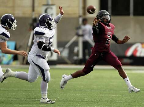 George Ranch quarterback Timon Nolan, right, throws a pass as Elgin's Daryl Scott (62) defends during the first half of a high school football playoff game, Saturday, November 30, 2013, at the Berry Center in Cypress. Photo: Eric Christian Smith, For The Chronicle