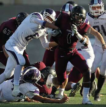 George Ranch's Darius Anderson, right, muscles his way past Elgin's Gabriel Perez during the second half of a high school football playoff game, Saturday, November 30, 2013, at the Berry Center in Cypress. Photo: Eric Christian Smith, For The Chronicle