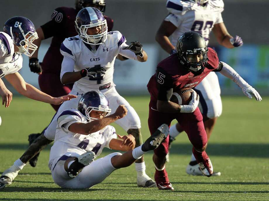 George Ranch's Xavian Marks, right, breaks the tackle of Elgin's Jordan Smith during the second half of a high school football playoff game, Saturday, November 30, 2013, at the Berry Center in Cypress. Photo: Eric Christian Smith, For The Chronicle