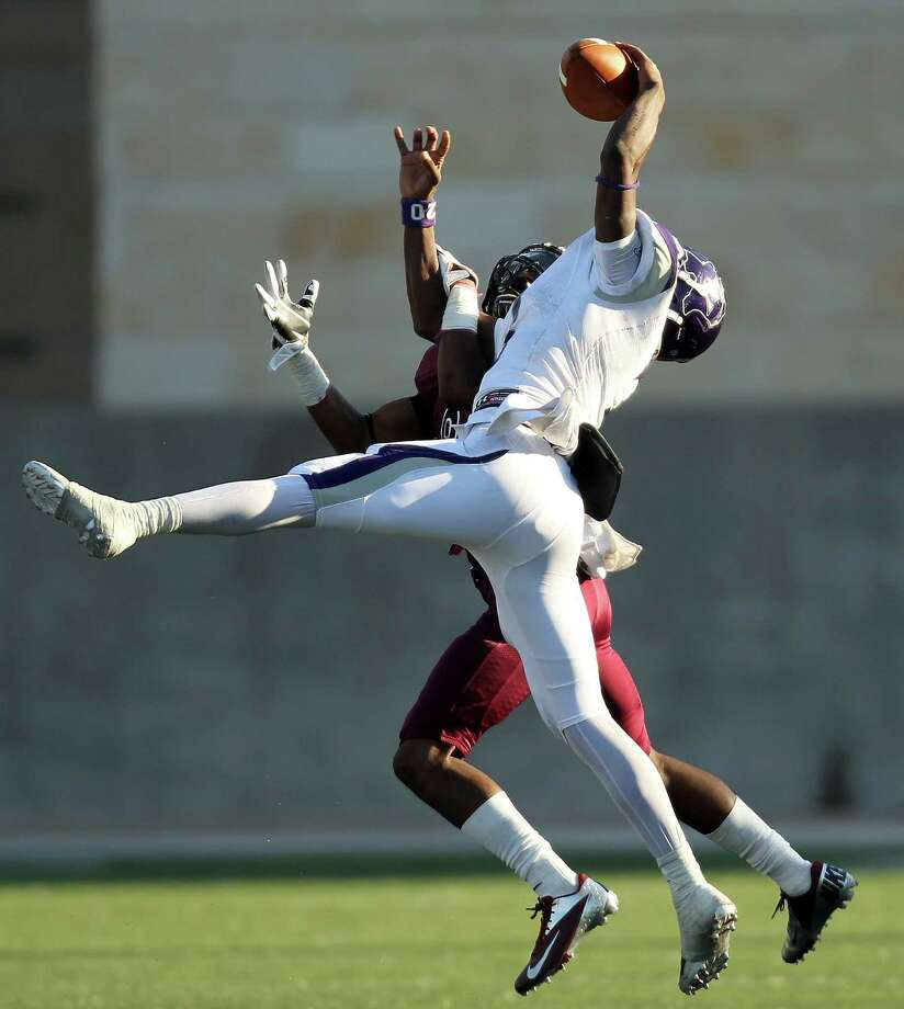 George Ranch 37, Elgin 20Elgin's Anthony Nash, right, makes a one-handed reception as George Ranch's Torin Marks defends during the second half of a high school football playoff game, Saturday, November 30, 2013, at the Berry Center in Cypress. Photo: Eric Christian Smith, For The Chronicle