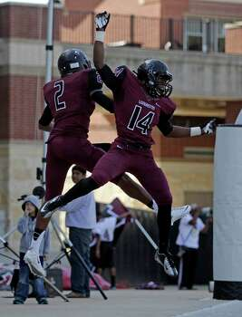 George Ranch's Timon Nolan (2) celebrates his touchdown run with teammate Marcellas Baker during the first half of a high school football playoff game against Elgin, Saturday, November 30, 2013, at the Berry Center in Cypress. Photo: Eric Christian Smith, For The Chronicle