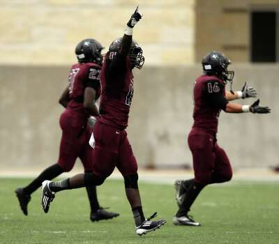 George Ranch's Alfred Wande, center, celebrates his interception during the second half of a high school football playoff game against Elgin, Saturday, November 30, 2013, at the Berry Center in Cypress. Photo: Eric Christian Smith, For The Chronicle