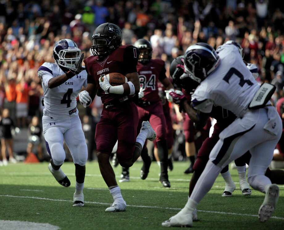 George Ranch's Darius Anderson (1) scores a touchdown as Elgin's De'Kovin Vincent (4) defends during the first half of a high school football playoff game, Saturday, November 30, 2013, at the Berry Center in Cypress. Photo: Eric Christian Smith, For The Chronicle