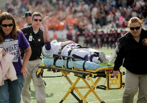 Elgin's James Biddy acknowledges the crowd's applause while being carted off the field after sustaining an injury during the first half of a high school football playoff game against George Ranch, Saturday, November 30, 2013, at the Berry Center in Cypress. Photo: Eric Christian Smith, For The Chronicle