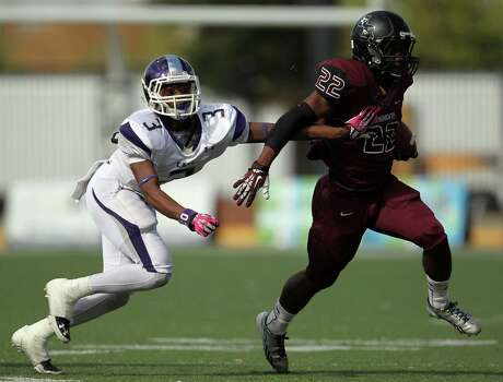 George Ranch's Collins Kwabena, right, breaks the tackle of Elgin's Anthony Nash during the first half of a high school football playoff game, Saturday, November 30, 2013, at the Berry Center in Cypress. Photo: Eric Christian Smith, For The Chronicle