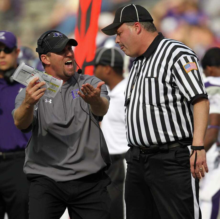 Elgin head coach Wade Griffin, left, argues with an official during the first half of a high school football playoff game against George Ranch, Saturday, November 30, 2013, at the Berry Center in Cypress. Photo: Eric Christian Smith, For The Chronicle