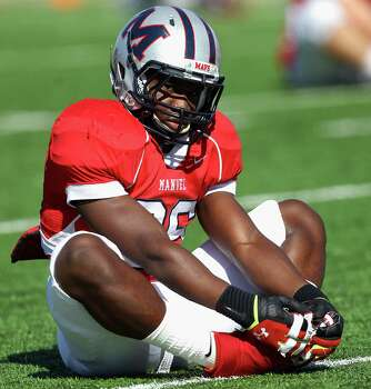 Manvel's Leonard Owens stretches before playing Memorial during a high school playoff football game Saturday, Nov. 30, 2013 at Mercer Stadium in Sugar Land, Texas. (Bob Levey/Special To Chronicle) Photo: Bob Levey, Special To The Chronicle / ©2013 Bob Levey