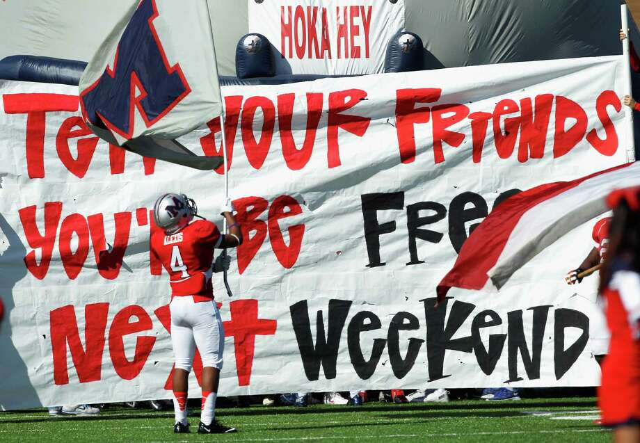 Manvel's Austin Alexis prepares to bring his team onto the field against Memorial during a high school playoff football game Saturday, Nov. 30, 2013 at Mercer Stadium in Sugar Land, Texas. (Bob Levey/Special To Chronicle) Photo: Bob Levey, Special To The Chronicle / ©2013 Bob Levey