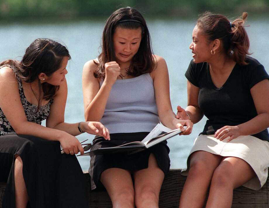 Some things don't change, like checking out the Franklin yearbook soon after it comes out. From left to right, juniors Cheryl Tantoco, Tesa Lau and Suzanne Prom crack open a new annual at Stan Sayres Park in 1998. Lau was yelling that the yearbook had spelled her name wrong.  Photo: MIKE URBAN, -