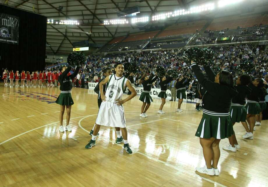 Franklin star guard Peyton Siva revels in the crowd's enthusiasm during his intro before a playoff game against Ferris High School in Tacoma Dome on Mar. 2, 2007.  Photo: Scott Eklund, - / Seattle Post-Intelligencer