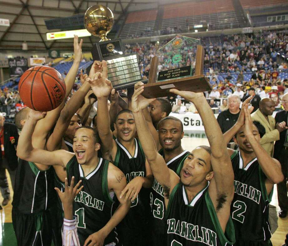 Franklin High School players, left to right, Venoy Overton (1), Peyton Silva (3), Jordan Daisy (33) and Daniel Vasquez celebrate a 70-51 