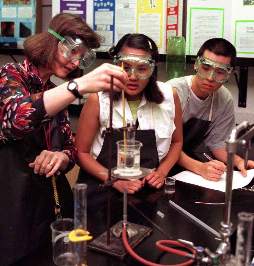 Chemistry class at Franklin High School, 1998. Pictured is teacher Sandi Everlove with students Regena Reyes and James Piek.  Photo: KURT SMITH/PI, -