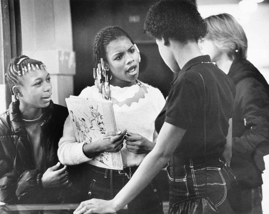 This archive photo of Franklin students had no legible date, but that Pee Chee folder dates it to possibly the awesome '80s. Pictured are freshmen Renee Jordan, left, and Kim Gross talking to friends.  Photo: -