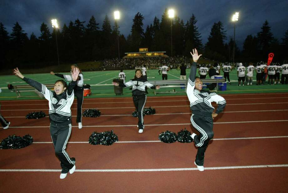 Franklin High School cheerleaders show off some Quaker spirit during a game against the Redmond Mustangs in 2007.  Photo: Karen Ducey, -