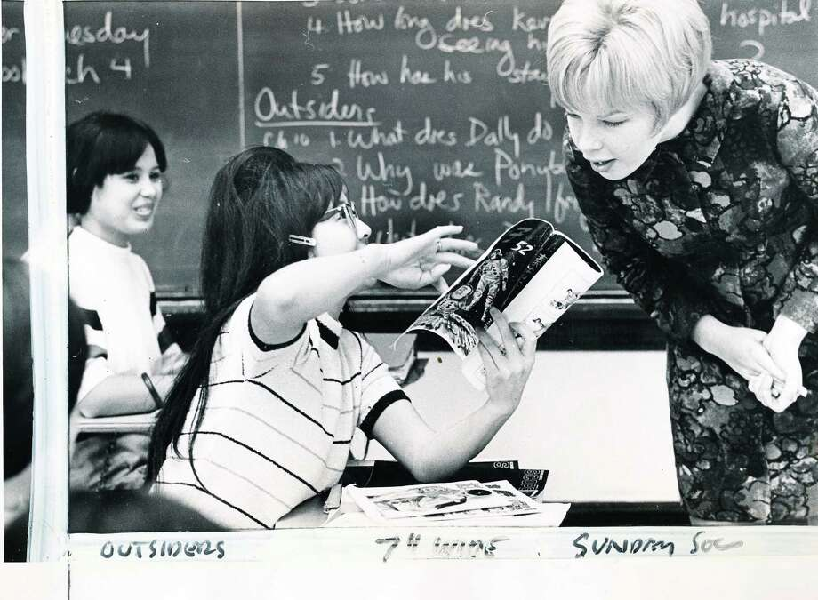"A Franklin classroom in 1969. For fans of S.E. Hinton, check out the questions about ""The Outsiders"" on the chalkboard. The original caption of this photo said, ""Student Mimi Louie and Cadet Shirley Pajari find English lessons in the comics."" Photo: -"