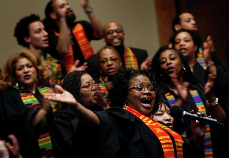 Seattle's famous choir, the Total Experience Gospel Choir, got its start in the '70s as a gospel group at Franklin High School. The choir is pictured in 2008 with the Black Nativity Choir and soloist Erika Moore during a Martin Luther King celebration. Photo: ANDY ROGERS, - / SEATTLE POST-INTELLIGENCER