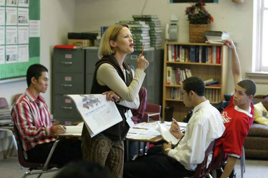 Franklin classroom, 2004. Pictured is teacher Christine Roux, using The Wall Street Journal to teach finance.  Photo: SCOTT EKLUND, -