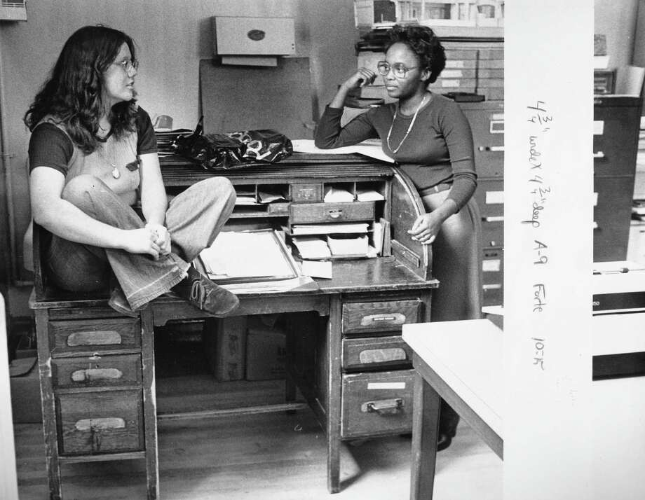 Franklin High School journalism students Tess Forte, left and Debra Jean Rivers sit on a roll-top desk in 1978 that was at the center of some kind of controversy that year. Photo: -