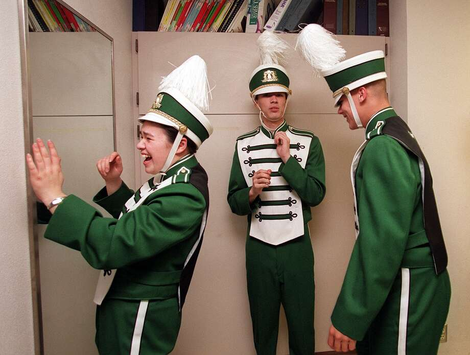 Franklin High School marching band members Kasi Farrar, Marcus  Alfonzo and  Matt Emmick check out their new uniforms in 2000, the year the band got new uniforms for the first time and performed in Ireland for St. Patrick's Day. Photo: PAUL KITAGAKI JR., -