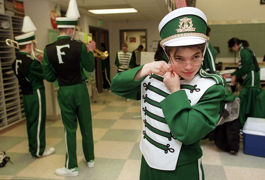 Alida Hupf, a sax player in the Franklin High School marching band, adjusts her hat in 2000, the year the band got new uniforms for the first time and performed in Ireland for St. Patrick's Day.  Photo: PAUL KITAGAKI JR., -