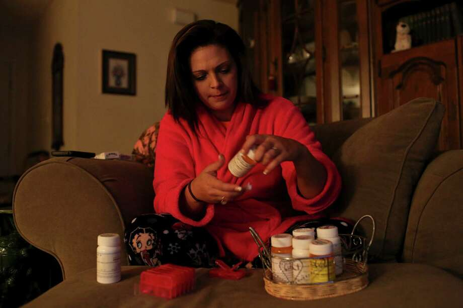 Virginia Messick takes five medications to treat the symptoms of PTSD, a result of her sexual trauma. Photo: Lisa Krantz, San Antonio Express-News / San Antonio Express-News