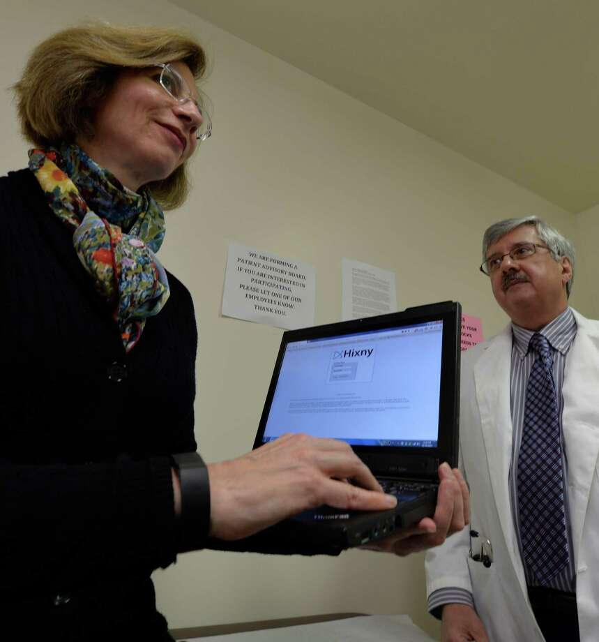 Bonnie Chavin shows how a patient would be able to access NIXNY to check her medical history as she confers with Dr. James Aram in his office Monday afternoon Nov. 25, 2013 in Brunswick, N.Y.        (Skip Dickstein/Times Union) Photo: SKIP DICKSTEIN / 00024778A