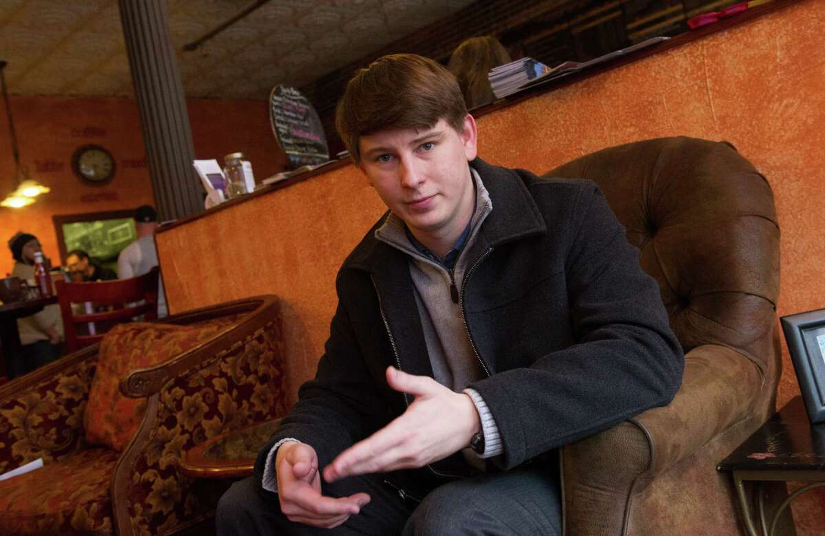 Bart Murawski, 27 poses at a coffee shop Tuesday, Nov. 26, 2013, in Troy, N.Y. You can take our word for it: Americans don?'t trust each other anymore. An AP-GfK poll conducted last month found that Americans are suspicious of each other in everyday encounters. Less than a third expressed a lot of trust in clerks who swipe their credit cards, drivers on the road, or people they meet when traveling.