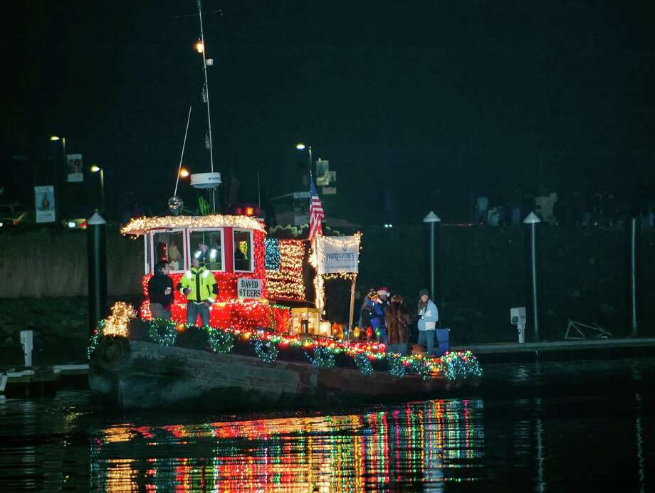 A tugboat participating in the annual Thanksgiving weekend Stamford Harbor Parade of Lights travels in the West branch of Stamford Harbor, Stamford, CT on Saturday, November, 30th, 2013. Photo: Mark Conrad / Connecticut Post Freelance