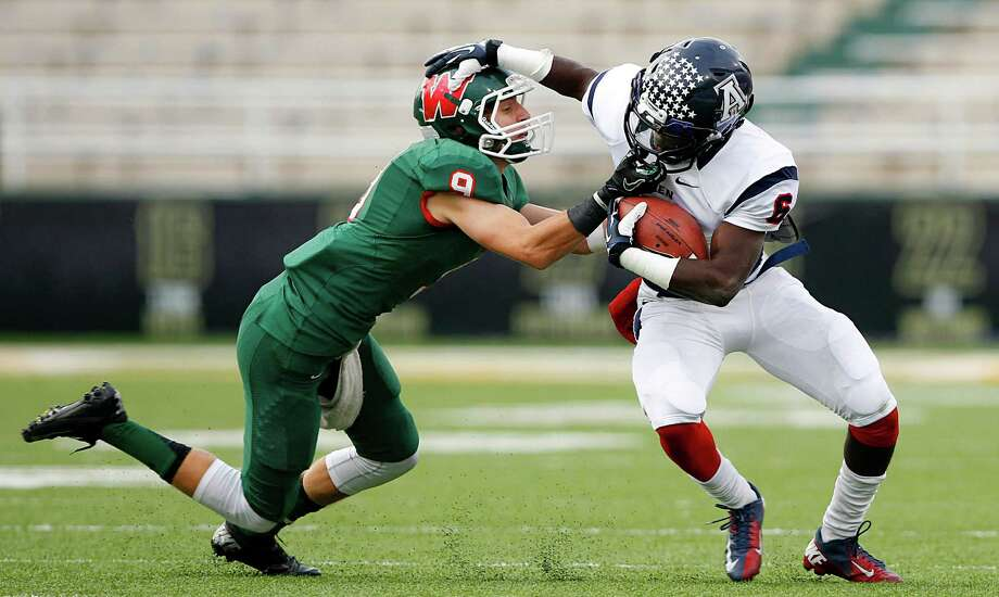 The Woodlands defensive back Tyler Murphy (9)  was called for a face mask as he tries to tackle Allen wide receiver Kendall Clinton (6) after a short pass in the Class 5A Region Il Semifinal at Floyd Casey Stadium in Waco, Saturday, November 30, 2013.  Allen defeated The Woodlands, 56-21. (Tom Fox/The Dallas Morning News) Photo: Tom Fox / The Dallas Morning News