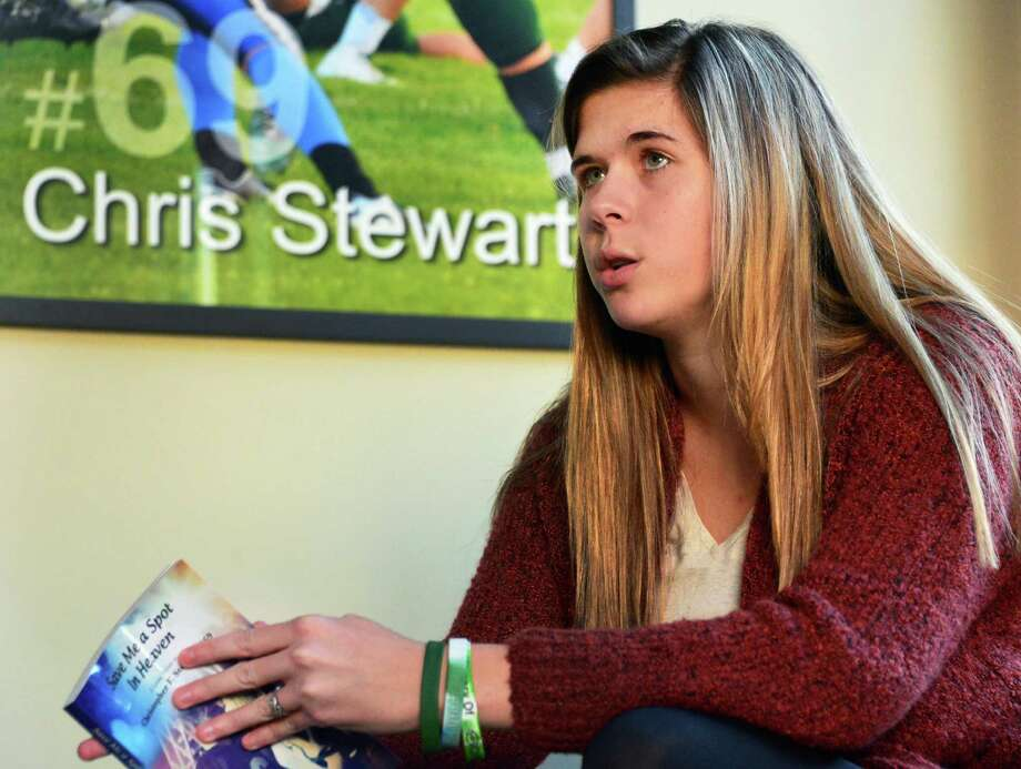 Bailey Wind, a survivor of last December's Northway accident, holds her book as she speaks about her life since the accident during an interview at her family's home Friday Nov. 29, 2013, in Colonie, NY.  (John Carl D'Annibale / Times Union) Photo: John Carl D'Annibale / 00024822A